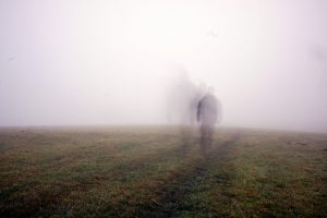 Picture of a person on a moor that looks like a ghost in the fog