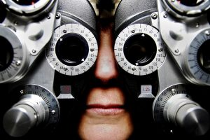 Picture of person with optometrist's machinery over their eyes