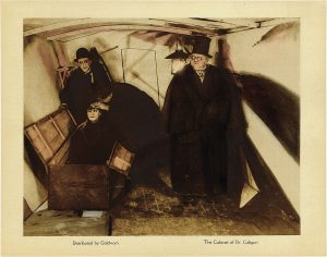 postcard with Dr. Caligari standing next to a coffin where his somnambulist Cesare is sitting, from the film