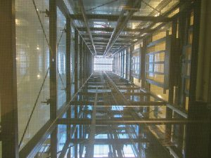 looking up through an elevator shaft towards the light